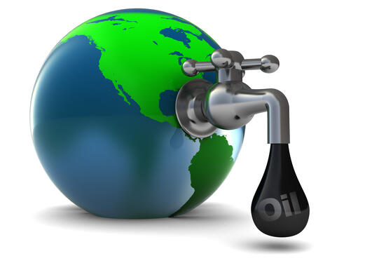 Jordkloden med en kran som drypper olje