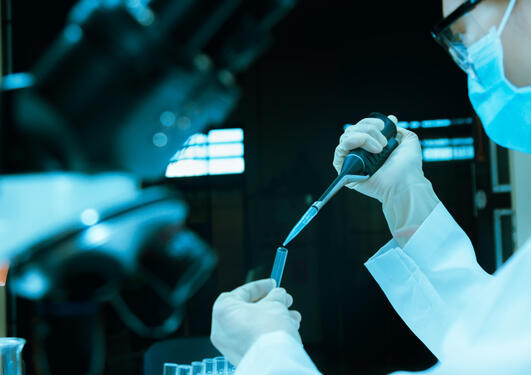 Scientist taking aliquote of an enzyme in modern lab,Young scientist works in modern biological lab,science concept,science people and selective focus, stock photo