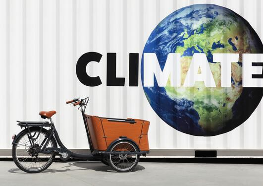 image of a bike with planet earth and text saying climate