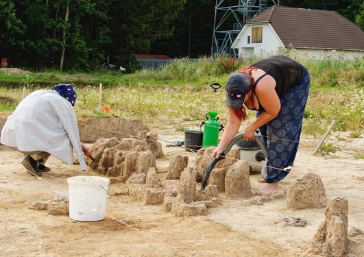 Two women working on an archaeological site.