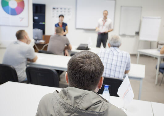 People in a room where a course is taking place