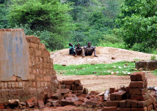 The sad children who look at their collapsed school in Sinazeze, Zambia, stock photo