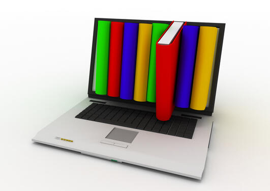 Books coming out of a laptop-screen
