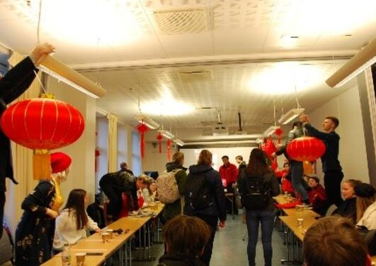students decorating for the chinese new year celebration
