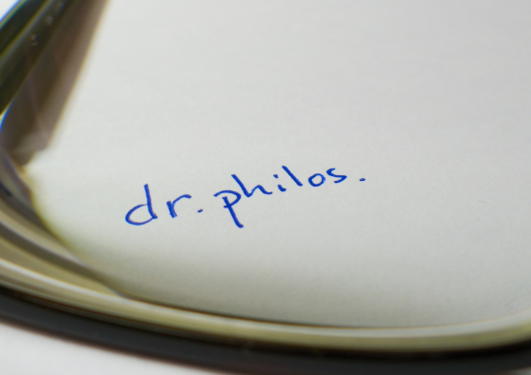Dr.philos written on paper