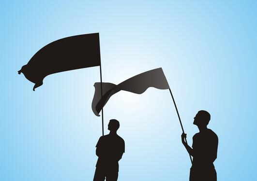 An illustration of two men holding flags, symbolising nations.