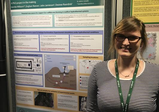 Henrike presenting her poster