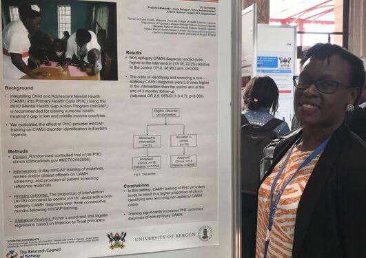 PhD candidate presenting her poster