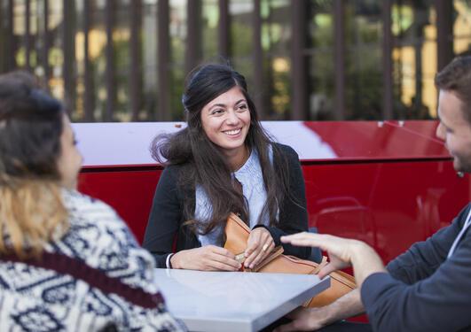 Three students sitting and talking