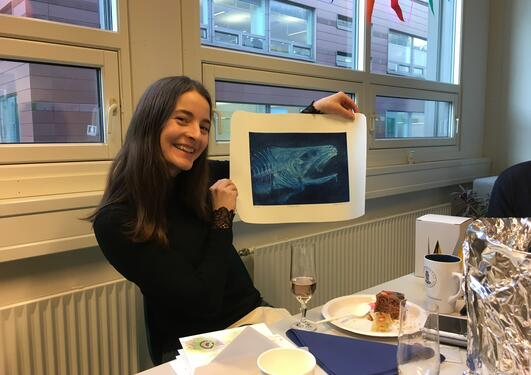 Christine holding up a print of a cod head