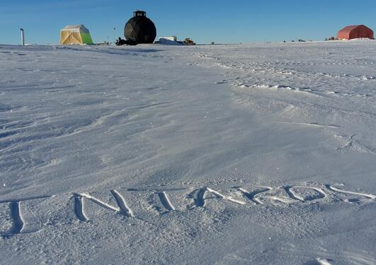 Intaros written on top of snow