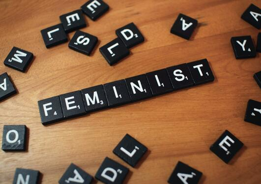 Scrabble tiles spelling out feminism
