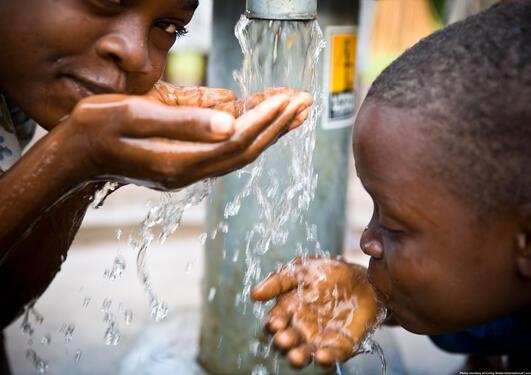 Kids drinking water from tap