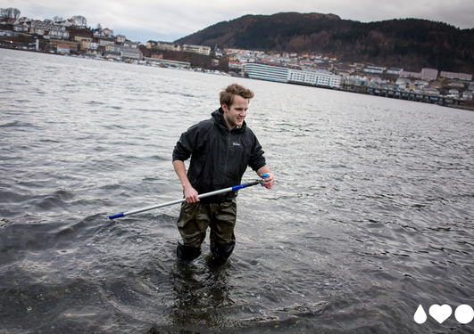 Student doing research in the water