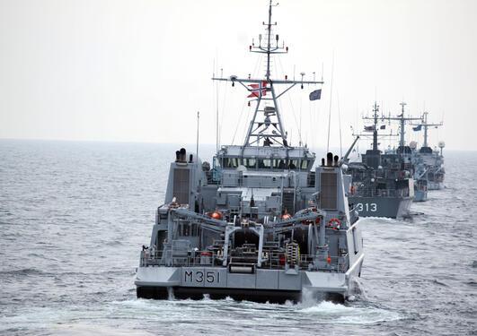 Naval ships sailing.
