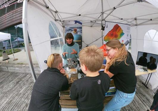 K.G. Jebsen PhD students by their stand at the Passion for Ocean festival.