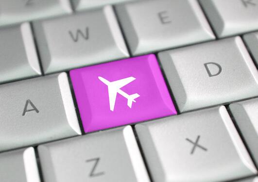 illustrasjon som viser en tastatur knapp med flymotiv