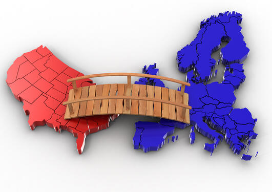An illustration of a bridge between USA and Europe.