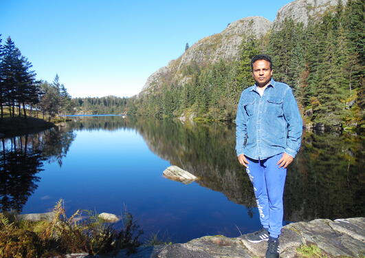 Dr Asela Perera hiking above Bergen