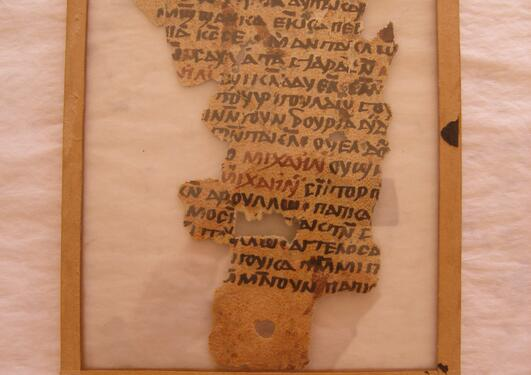 Photo of an old nubian manuscript within a frame