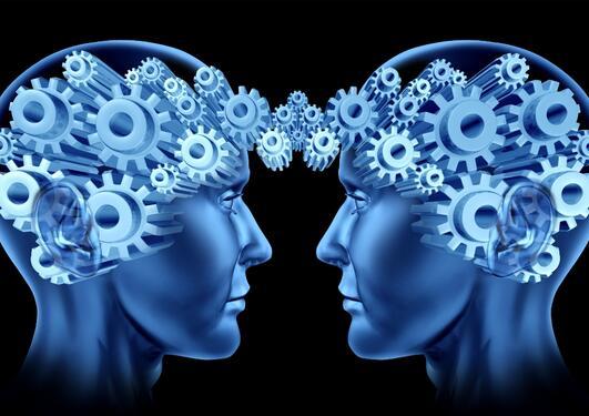Bilde av to hoder i profil med tannhjul som går over i hverandre