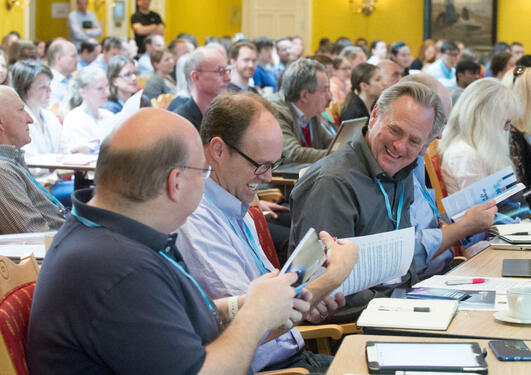 Photo from the audience at the CCBIO Annual Symposium 2016, clearly with a good atmosphere as people are smiling.