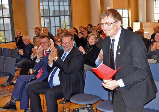 Publikum i Aulaen under sermonien for at Universitetsbiblioteket overtar språksamlingen