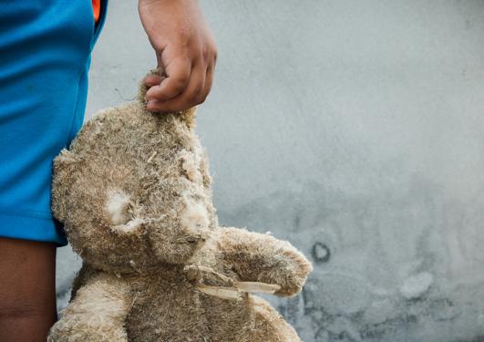 Child holding teddy