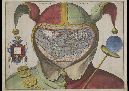 Picture of a map of the world in form of a head wearing a fool's cap.