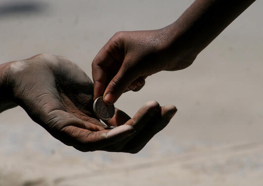 Tigging, To hender med mynt