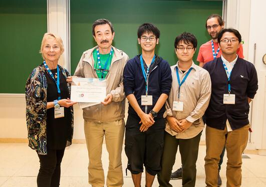 Frances Rosamond presenting award to the japanese team