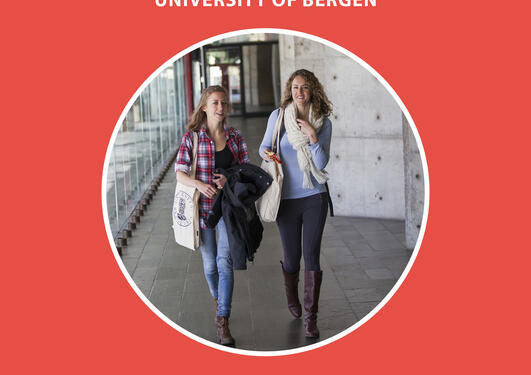 Two female students walking down a corridor