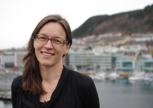 Vigdis Vandvik in front of a back drop of the city of Bergen
