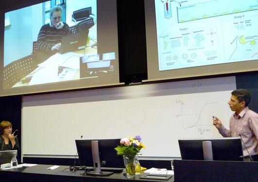 Prof. K. A. Dawson (on screen), M. Dusinska (left), Z.E. Allouni (right)