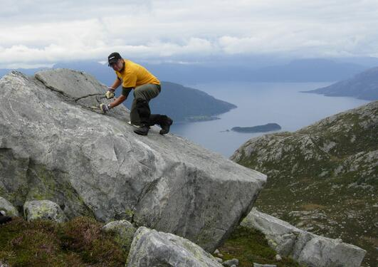 Sampling boulder for exposure dating. The Hardangerfjord in the background.