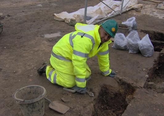 Archaeologist Mahmoud Suliman Bashir at an excavation site in northern England.